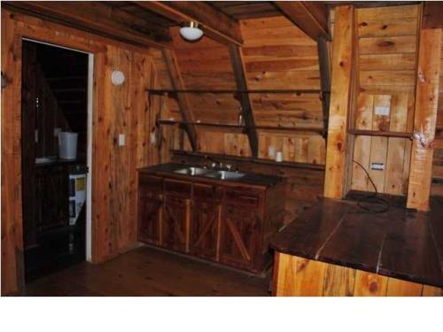 Dise o de linda y peque a caba a de madera for Cabanas de madera pequenas