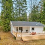 Plano de casa de madera de 56m2 con 2 dormitorios